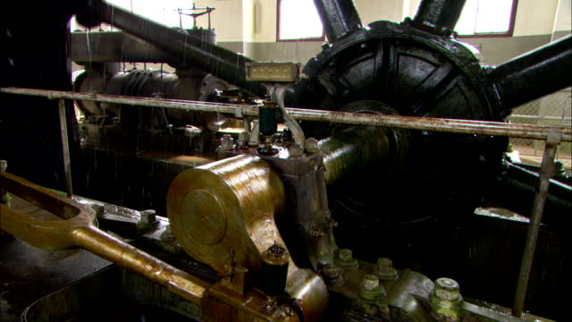a mechanical wheel operates in a water pumping station. - pumping station stock videos & royalty-free footage