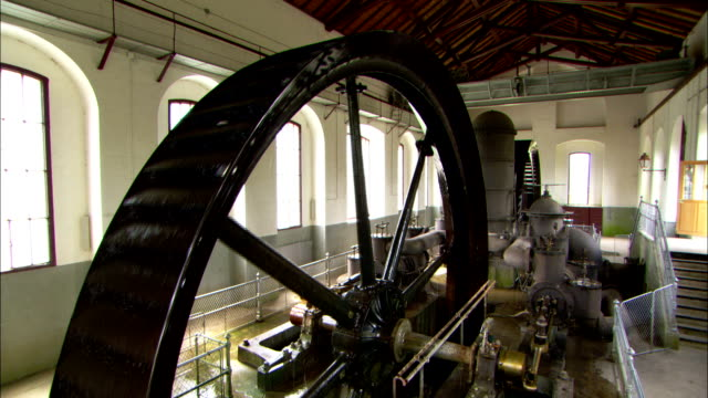 a mechanical wheel operates in a water pumping station. - water pumping station stock videos & royalty-free footage