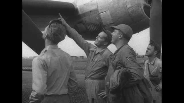 mechanics attach tractor to airplane on japanese airfield during korean war/ group of united states air force personnel stands next to plane / man... - other stock videos & royalty-free footage