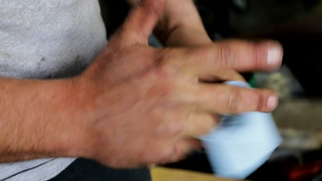 mechanic's hands - lubrication stock videos & royalty-free footage