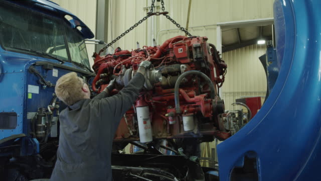 mechanics lifting and removing truck engine with crane in garage / aurora, utah, united states - engine stock videos & royalty-free footage