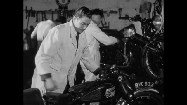 MONTAGE Mechanics work on motorcycles before the race / England, United Kingdom