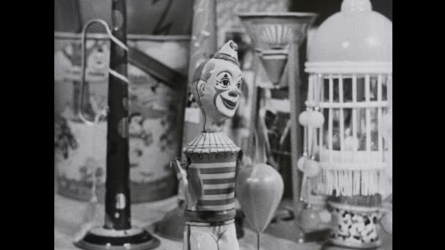 1939 mechanized clown toy strikes punching bag - toy stock videos & royalty-free footage
