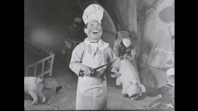 1939 Mechanized miniature village chef laughs as he sharpens knives