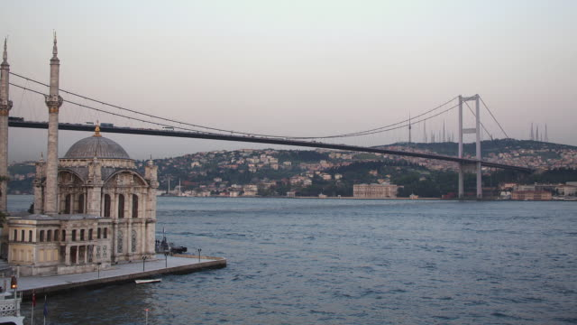 t/l ws mecidiye mosque and bosphorus bridge, day to night transition, istanbul, turkey - bosphorus stock videos & royalty-free footage