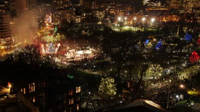 Med Shot Aerial TL Boston Common of Firework during Christmas Tree Lighting Event in Boston Common.