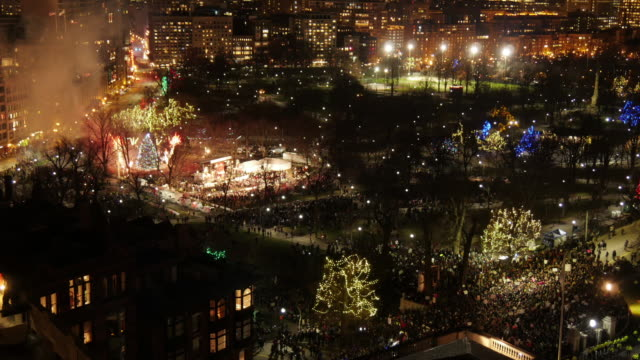 Med Shot Aerial TL Boston Common of Firework during Christmas Tree Lighting Event in Boston Common. Zoom Out