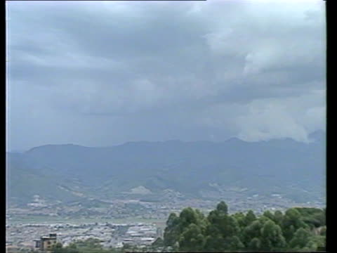 Medellin EXT TGVs of city as thunder lightning around