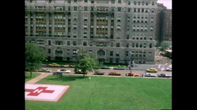 vídeos de stock, filmes e b-roll de medevac helicopter arrives at cook county hospital; 1979 - helicopter landing pads