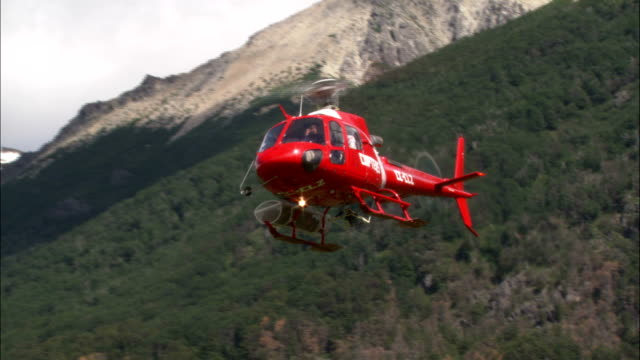 a medevac helicopter lands in a roped off area. - roped off stock videos and b-roll footage