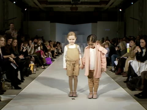 vídeos de stock e filmes b-roll de media and vips attend event showcasing autumn and winter 2013 collections as part of the inaugural twoday fashion event dedicated to childrenswear... - desfile de moda