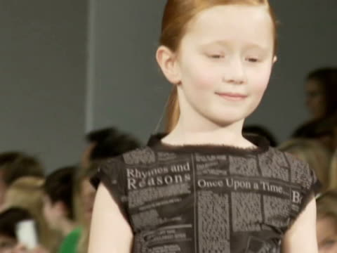 media and vips attend event showcasing autumn and winter 2013 collections as part of the inaugural two-day fashion event dedicated to childrenswear.... - sfilata video stock e b–roll