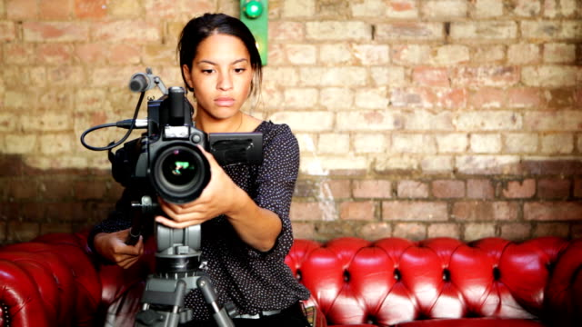 media: attractive camera operator - television camera stock videos and b-roll footage
