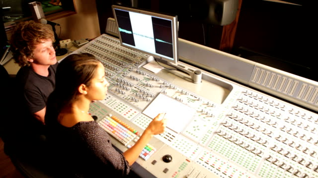 media: audio engineers at mixing desk - producer stock videos & royalty-free footage