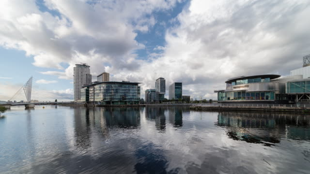t/l media city in salford quays, manchester, uk - river stock videos & royalty-free footage