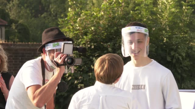 atmosphere media interview wearing face shields at 'break' world premiere on july 22 2020 in london englandthe drivein club in north london hosts the... - film premiere stock videos & royalty-free footage