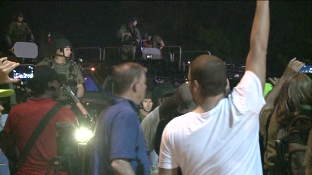 media members with cameras surround a police tank with police officers on top on august 20, 2014 in ferguson, missouri. - tank stock videos & royalty-free footage