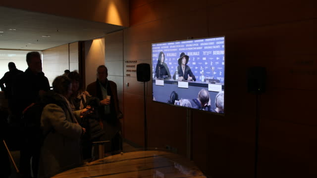 """media representatives can follow the press conference with the cast of the film """"there is no evil"""" on screens in the foyer of the grand hyatt hotel... - film screening stock videos & royalty-free footage"""