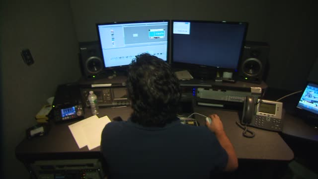 media technology inside a broadcast news station editor in edit bay on july 24, 2013 in new york, new york - editor stock videos & royalty-free footage