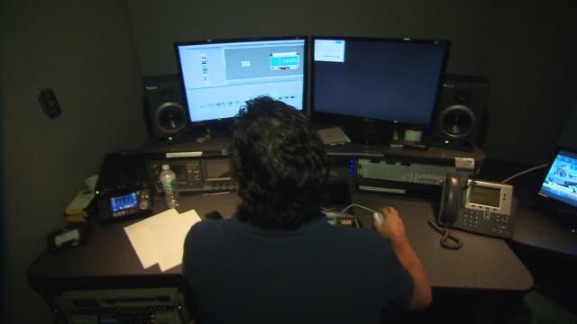 vídeos de stock e filmes b-roll de media technology inside a broadcast news station editor in edit bay on july 24, 2013 in new york, new york - editorial