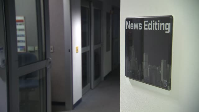 media technology inside a broadcast news station news editing sign in hallway on july 24 2013 in new york new york - film editing stock videos & royalty-free footage