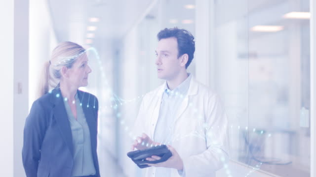 medic and consultant in a meeting walking through hospital - medical sales representative stock videos & royalty-free footage