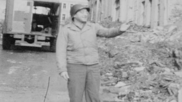 / Medic Truck parked in front of destroyed building / Dr Captain John Scillieri poses for camera / Medic Inspecting WWII War Damage on November 25...