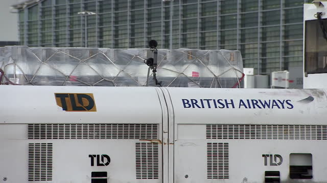 medical aid, including oxygen cylindars, loaded onto british airways plane to be sent from uk to india to help in their fight against the coronavirus... - healthcare and medicine stock videos & royalty-free footage