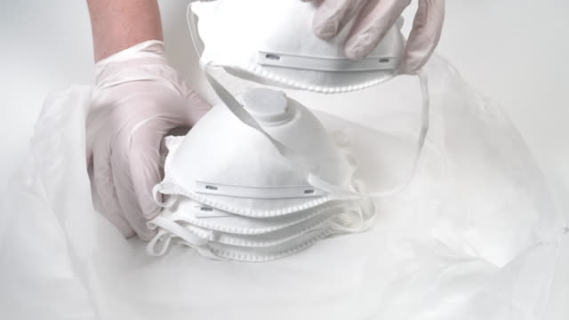 medical assistant distributing respirator masks - hygiene stock videos & royalty-free footage