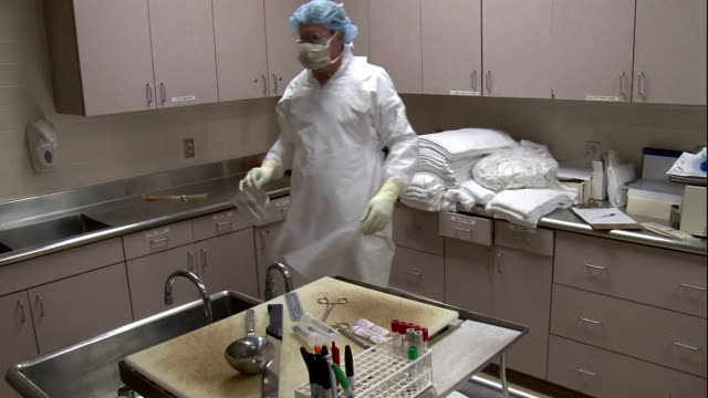 a medical coroner prepares to do an autopsy. - autopsy stock videos & royalty-free footage