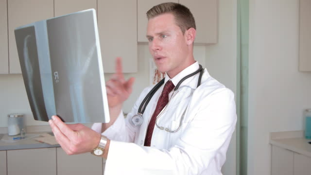 medical doctor checking x ray - scientific imaging technique stock videos and b-roll footage