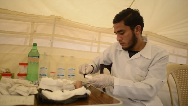 Medical Equipe near the Israeli border fence east of Gaza City in the central Gaza Strip on April 13 2018 Several thousand Gazans gathered for a...