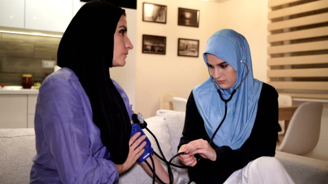 medical help at home,modern arab women - headscarf stock videos & royalty-free footage