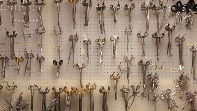 medical instruments hanging on a wall - titanium stock videos and b-roll footage
