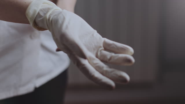 medical nurse puts medical gloves on. stock video - nurse stock videos & royalty-free footage