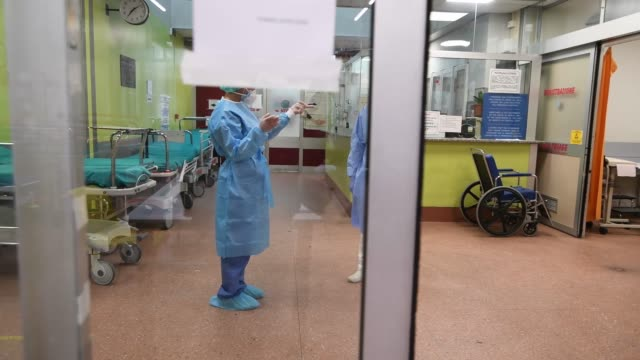 medical personnel in protective suits await the arrival of possible covid-19 infections in the molinette hospital lobby during on the italy extends... - anticipation stock videos & royalty-free footage