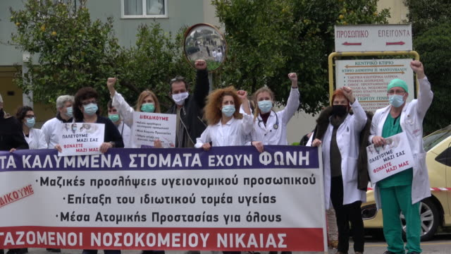 medical personnel of nikaia general hospital in athens stage a protest in the yard of the hospital, wearing surgical masks and holding placards,... - placard stock videos & royalty-free footage