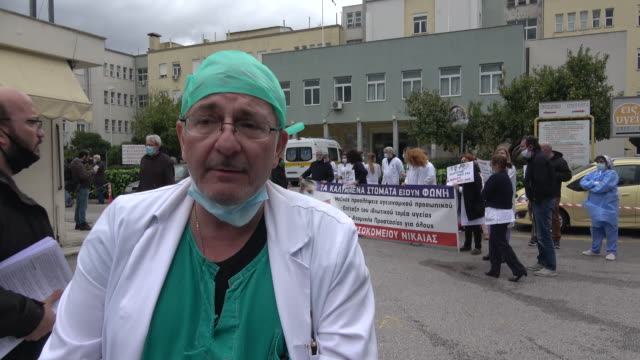 medical personnel of nikaia general hospital in athens stage a protest in the yard of the hospital, wearing surgical masks and holding placards,... - state of emergency stock videos & royalty-free footage