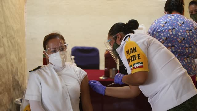 medical personnel of the mexican army receive the application of the vaccine as part of the first stage of mexico's covid-19 vaccination campaign at... - mexico stock videos & royalty-free footage