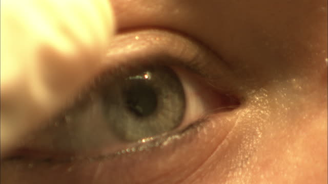a medical professional examines an eye. - female anatomy stock videos and b-roll footage