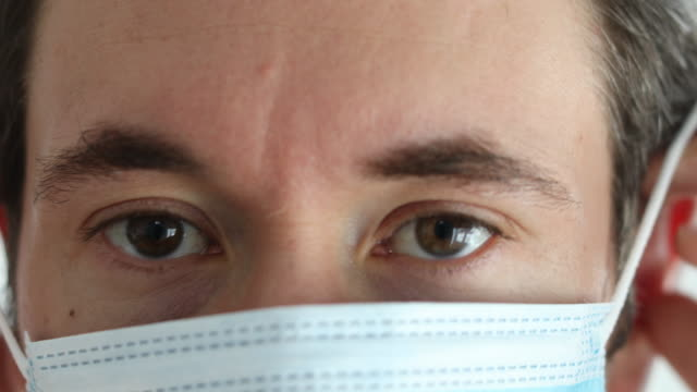 medical professional wearing a surgical face mask - heroes stock videos & royalty-free footage