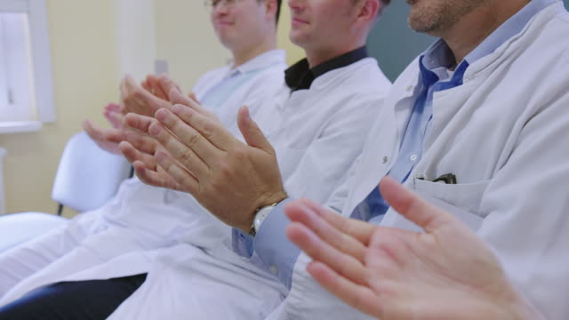 medical professionals clapping in a meeting at hospital - clapping hands stock videos & royalty-free footage