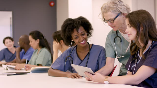 medical professionals in continuing education course - nurse stock videos & royalty-free footage