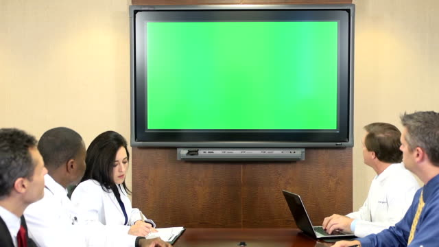 medical professionals participate in teleconference meeting - media training stock videos and b-roll footage