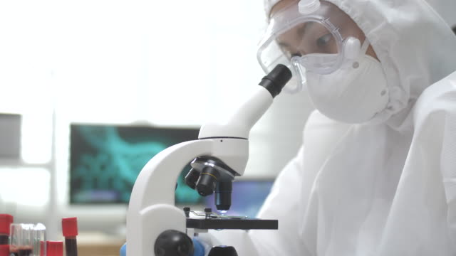 medical research scientist looking under the microscope - discovery stock videos & royalty-free footage
