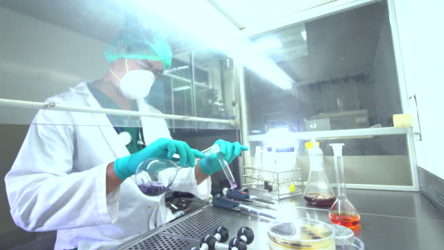 medical research scientist tests vaccine experimental drug in stem modern laboratory. - centro di ricerca video stock e b–roll