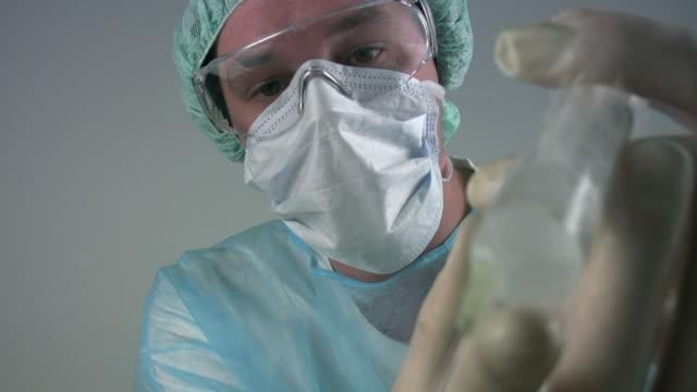Medical scientist 'injecting syringe'