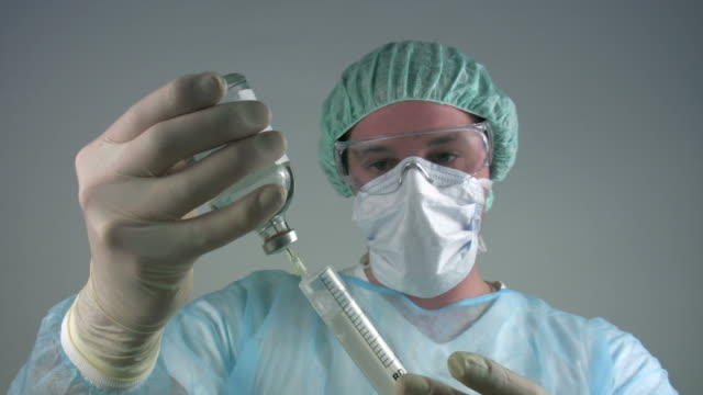 Medical scientist 'syringe injection'