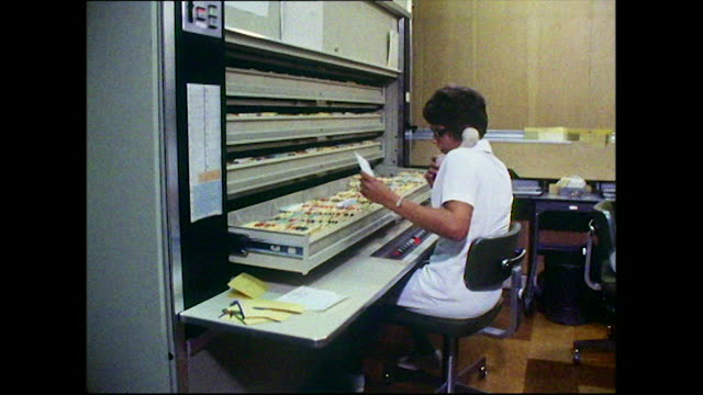 medical secretaries use a rotating filing system; 1972 - data stock videos & royalty-free footage