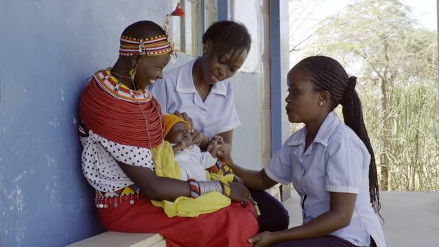 medical staff working in rural communities, kenya. - village stock videos & royalty-free footage